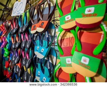 Krabi Town, Thailand - November 23 2019: A Local Shopkeeper Selling Flipflop Slippers At Krabi Weeke