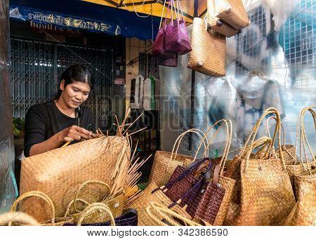 Krabi Town, Thailand - November 23 2019: Thai Woman Weaving Bags Out Of Bamboo In Krabi Weekend Nigh