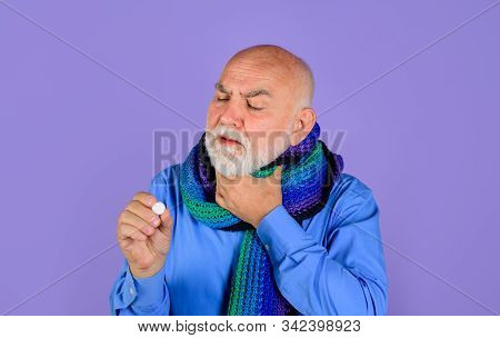 Man Wrapped In Scarf Suffering From Sore Throat. Treatment Pill. Medicine. Sore Throat. Senior Man T