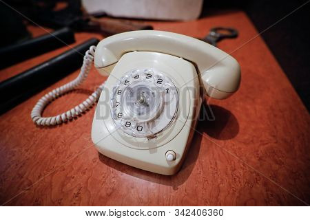 Details With A White Old Fashioned Dial Rotary Phone From The Communist Romania Era.