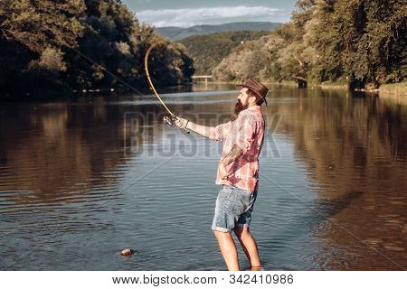 Happy Bearded Fisher In Water. Fishing On The Lake At The Morning. Gone Fishing. Fisherman With Rod