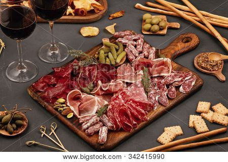 Appetizers Table With Differents Antipasti, Charcuterie, Snacks And Wine. Sausage, Ham, Tapas, Olive