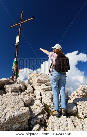 Hiker Pointing The Cross