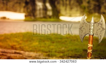 Equipment Of Viking Or Barbarian Warrior Outdoor On Nature. Viking Axe Against Norwegian Nature. Tou