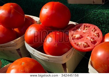 Red Ripe Tomatoes For Sale With Sample Slice