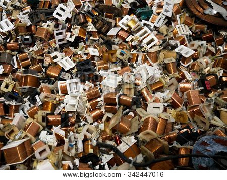 Wien/austria - June 4 2019: Pile Of Cooper Coil Inductors Used On Microwaves Ovens  In A Recycling A