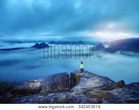 Darkness, Girl And Mountains. Silhouette Of Standing Woman On The Mountain Peak, Mountains And Dark