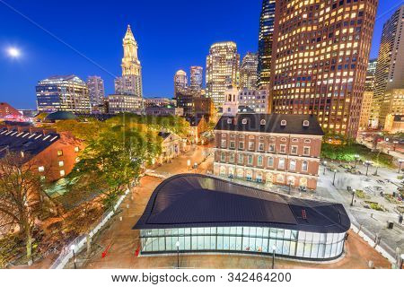 Boston, Massachusetts, USA skyline with Faneuil Hall and Quincy Market at night.