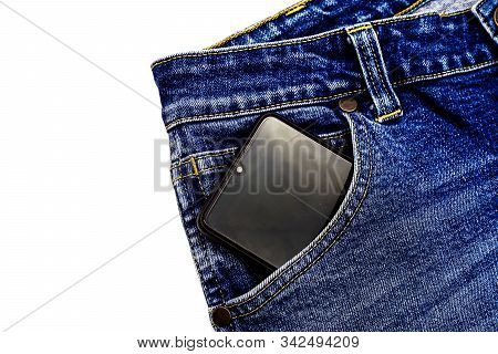 Denim Blue Jeans Fabric With Smartphone. Ripped Denim Blue Cloth Background, Text Place, Copy Space.