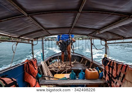 Inside In Thai Longtail Boat. View Of Empty Seats For Passengers And Life Jackets. The Sailor Contro