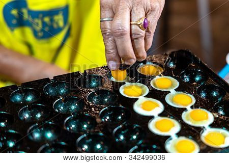 Hand Of An Elderly Thai Woman Preparing Fried Eggs Off Bird In Krabi Weekend Night Market In Krabi T