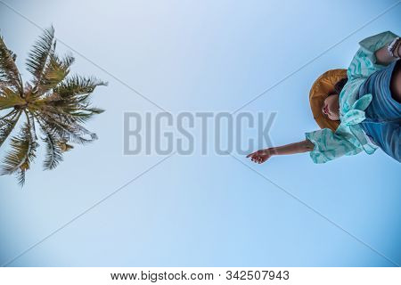 Woman Jumping Or Crossing Step Over At Beach