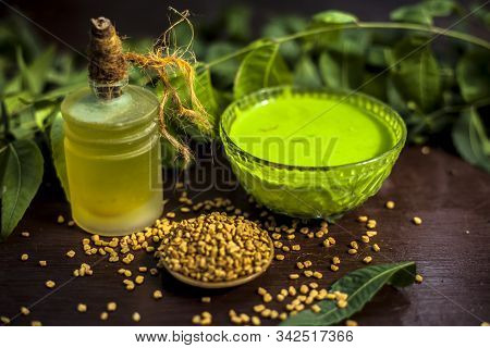 All Scalp Related Problems Solution Lotion Or Shampoo In A Glass Bowl Consisting Of Some Neem Leaves