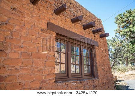 Windows And Vigas In Southwestern Stone Building
