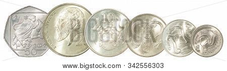 A Complete Set Of Cyprus Coins Stand In A Row One After Another. Isolated Over White Background.