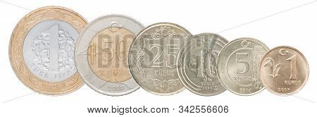 A Complete Set Of Turkish Coins Stand In A Row One After Another. Isolated Over White Background.
