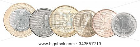 A Complete Set Of Brazilian Coins Stand In A Row One After Another. Isolated Over White Background.
