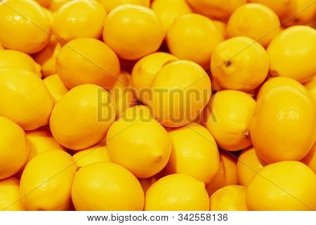 A Lot Of Bright Juicy Lemons. Vitamins And Health. Close-up. Background. Space For Text.