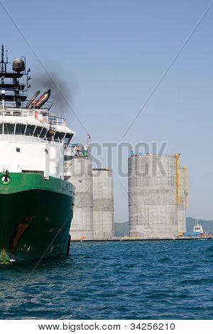 Base oil drilling platform and ocean going tug. Sea Japan. Russian coast.