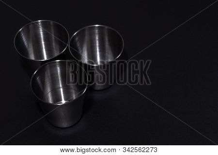 Modern Metal Stainless Steel Inox Glasses For Vodka - For Camping - Isolated On Black.