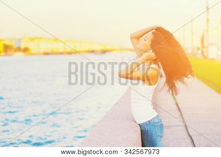 Side View Profile Portrait Of A Happy Brunette Woman Relaxing Breathing Fresh Air Outdoors In Summer