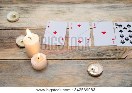 Cards For Divination Or Games, Lighted Candles On A Wooden Table. Concept Of Magic, Divination