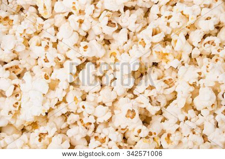 Close Up Tasty Scattered Salted Popcorn Texture Background