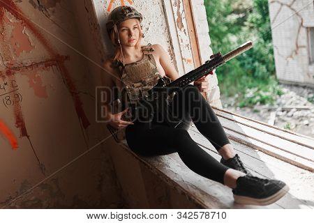 Sexy Woman In Uniform Posing In A Building.