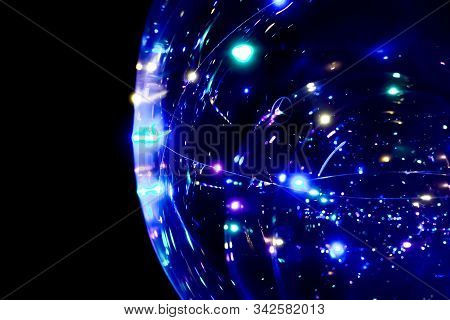 Colored Lights In The Form Of A Sphere On A Dark Background. Abstract Dark Background. Space Emulati