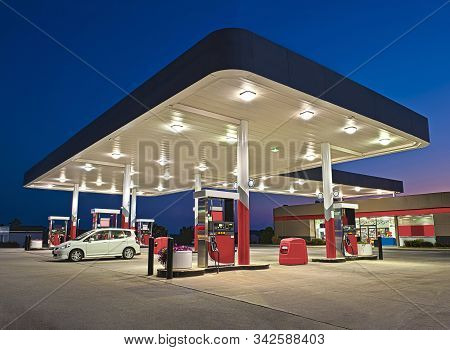 Horizontal Shot Of A Gasoline Station And Convenience Store Reworked.