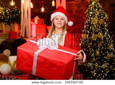 Generous Holiday. Happiness And Joy. Girl Santa Claus Costume Received Gift. Santa Crew. Santa Party