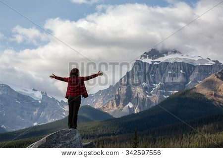 Girl Enjoying The Beautiful Scenery Of The Canadian Rockies During A Cloudy And Sunny Summer Day. Ta