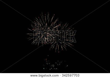Inexpensive Fireworks, Over The Black City Sky, Red And Yellow. For Any Purpose