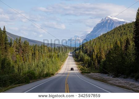 Scenic Road In The Canadian Rockies During A Vibrant Sunny And Cloudy Summer Morning. Taken In Icefi