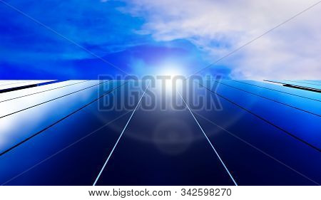 Solar Panels On Blue Sky Background. Photovoltaic Cells Of Solar Panel Generating Clean Energy From
