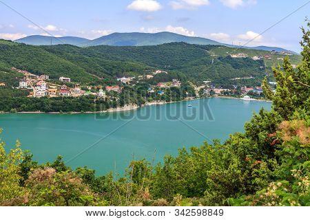 Abrau Lake And Abrau-durso Village By Novorossiysk On Sunny Summer Day. Caucasus Mountains, Russia.