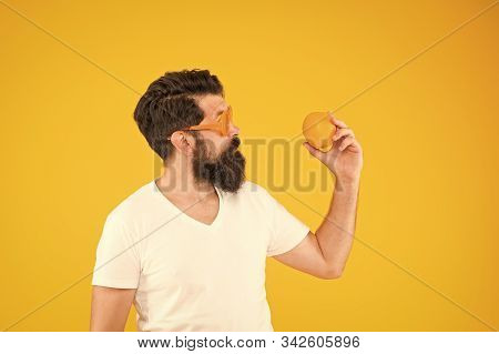 Enjoy The Taste Of Dieting Right. Dieting Expert Holding Orange On Yellow Background. Bearded Man Di