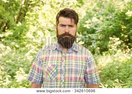 Brutal Style Trends. Bearded Man With Brutal Look On Natural Landscape. Caucasian Guy With Long Brut