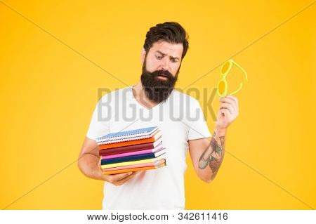 Education For Adults. Hipster Eccentric Student Hold Pile Books. Study Hard. Language Courses. Buy S