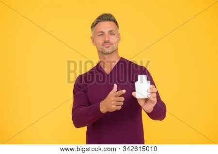 Helping To Make Better Shopping Decision. Handsome Man Point Finger At Bottle. Advertising Product.