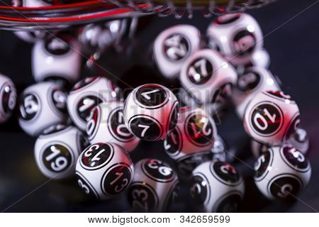 Black And White Lottery Balls In A Bingo Machine. Lottery Balls In A Sphere In Motion. Gambling Mach