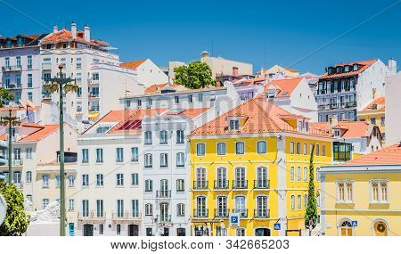 Portugal, Lisbon In Summer, Street Of Lisbon, Beautiful Yellow House Among White Houses In Lisbon, F