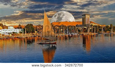 Luxor On The Nile With A Moonscape Background.  This Is A Popular Place For Tourist Boats To Moor Pr