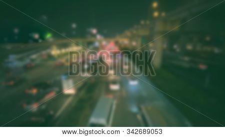 Blurred Of Car Brake Light On Traffic Jam Road Night. Traffic Jam In City Concept