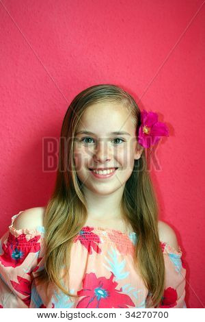 A beautiful blond-haired 13-years old girl, portrait