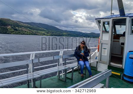 Loch Ness, Scotland - 31 July 2016 : A Tourist At A Tour Cruise On The Famous Loch Ness In Scottish
