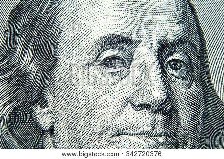 Close Up View Of 100 Dollar Banknote. Us President Benjamin Franklins Portrait On One Hundred Dollar