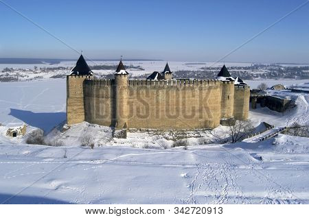 Khotyn Fortress In The Middle Of A Snowy Landscape