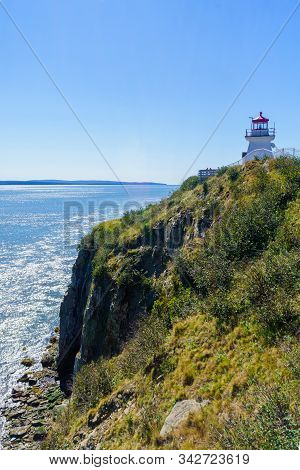 View Of The Cape Enrage Lighthouse, Shoreline And Cliffs, In New Brunswick, Canada