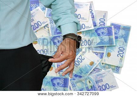 Hand Of Senior Businessman In Suit Turning Pocket Of His Trousers Inside Out And Showing It Empty. C